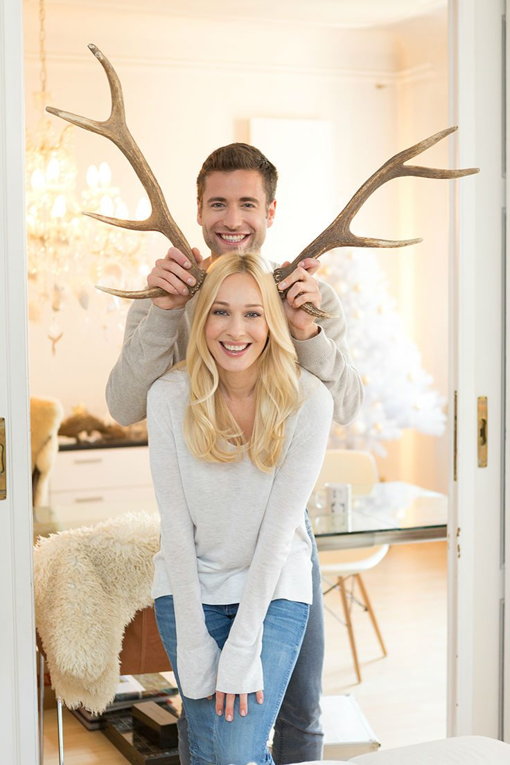 ¨A husband holds reindeer antlers next to his wife's head