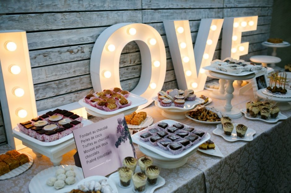 "A photo display showcasing a menu of the candy ""bar"" at a wedding - modern style"