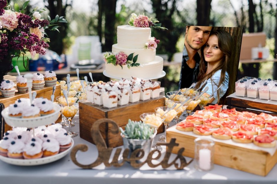 "A candy ""bar"" featuring delectable morsels, wedding cake, and a photo display showcasing a portrait of the bridal couple"