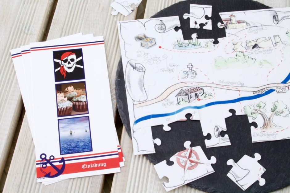 A treasure map on a photo puzzle and maritime pirate invitation cards