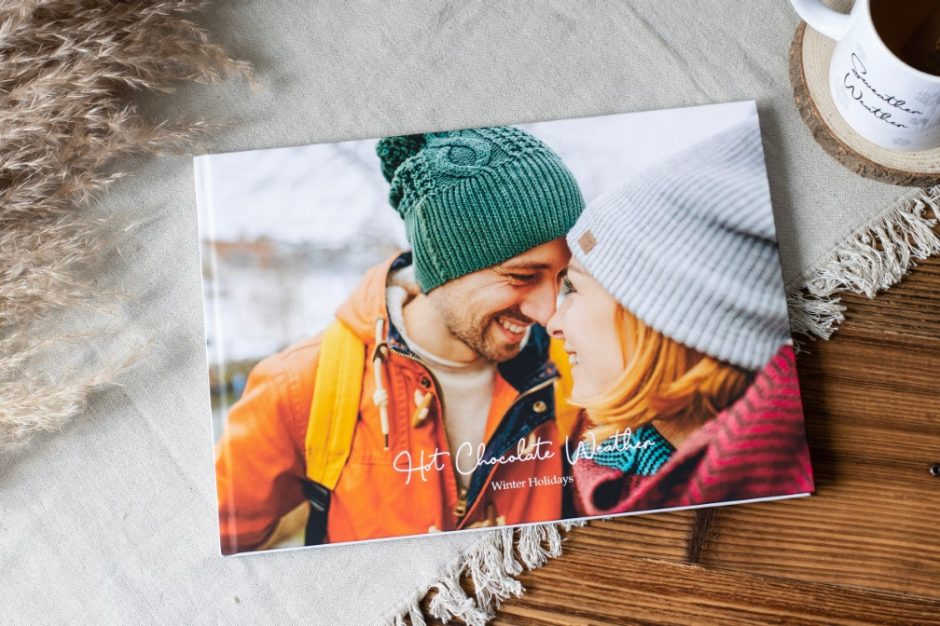 Winter holiday photo book with wintery landscapes