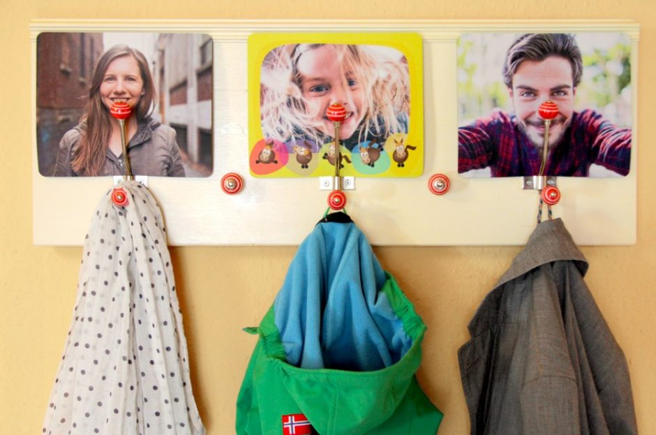 A DIY coat rack made with mouse pads featuring family photos