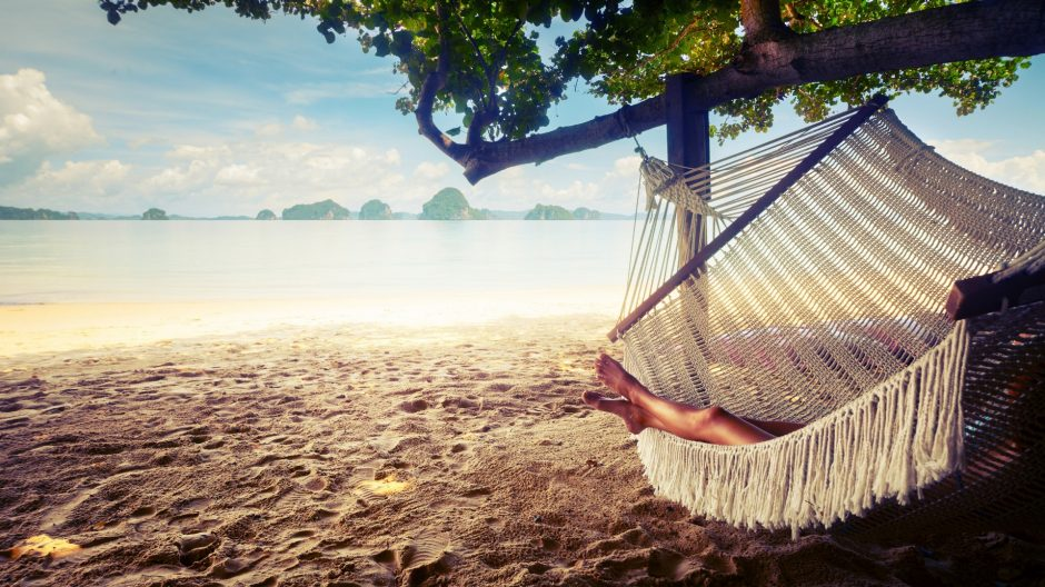 a-girl-relaxing-in-the-hammock-on-the-beach